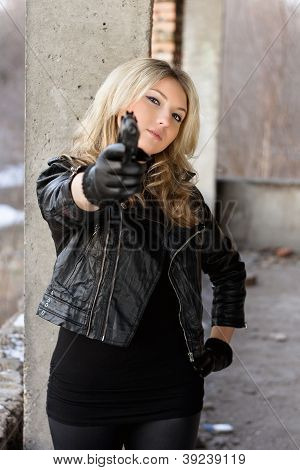Arrogant Young Woman With A Gun
