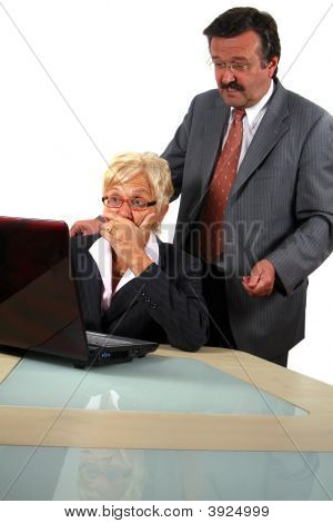 Senior Business Team Working On Laptop