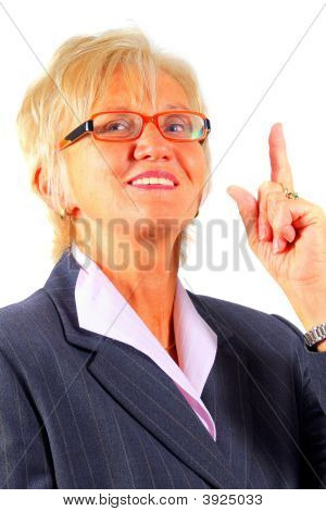 Mature Businesswoman Pointing Up