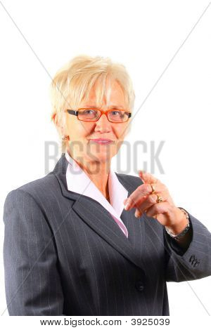 Mature Businesswoman Pointing At The Camera