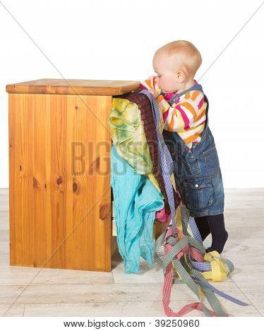 Determined Toddler Balancing On Tiptoe