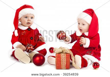two funny small kids in Santa Claus