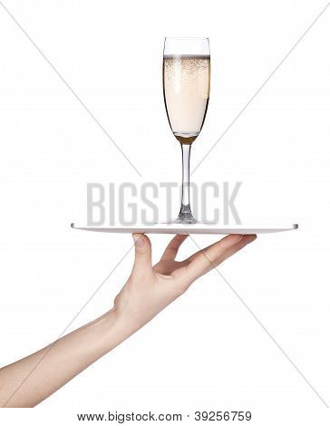 Hand Holding A Silver Serving Tray With Champagne