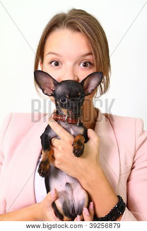 Attractive Young Woman With A Small Dog Isolated On White Background
