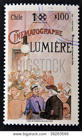 CHILE - CIRCA 1995: A stamp printed in chile shows poster commemorating the first movie of cinema ci