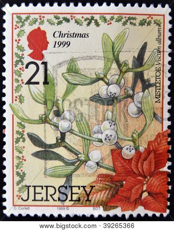 JERSEY - CIRCA 1999: A Christmas postage stamp printed in Jersey show mistletoe circa 1999