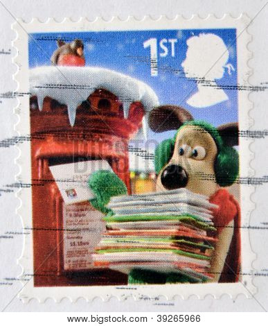 UNITED KINGDOM - CIRCA 2010: a stamp printed in Great Britain shows image of Gromit posting Christma