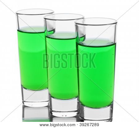 three glasses of absinthe isolated on white