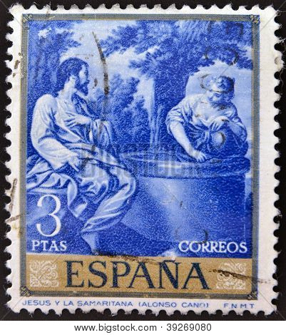 SPAIN - CIRCA 1969: A stamp printed in Spain shows painting Jesus and the Samaritan woman by Alonso