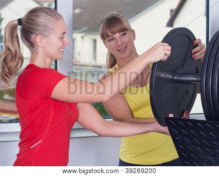 Two Blonde Women In Fitness-studio