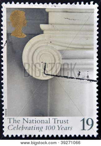 UNITED KINGDOM - CIRCA 1995: A stamp printed in Great Britain shows Fireplace Decoration. Attingham