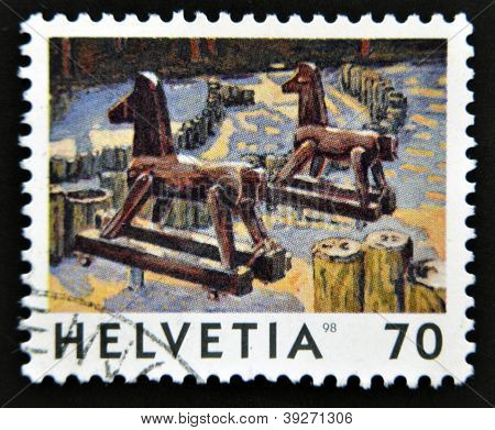SWITZERLAND - CIRCA 1998: A stamp printed in Switzerland shows the Deux Chevaux by Jean-Frederic Sch