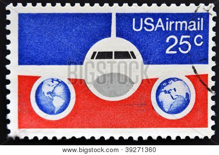 UNITED STATES OF AMERICA - CIRCA 1976: A stamp printed in USA showing a Boeing 737 airliner with bac