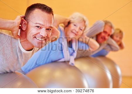 Happy group with seniors in a back course in fitness center