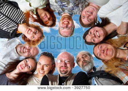 Happy Team On Blue Sky