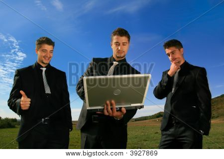Group Of Business Men Watching Laptop