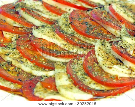 Caprese Appetizer Of Tomatoes, Mozzarella And Spices