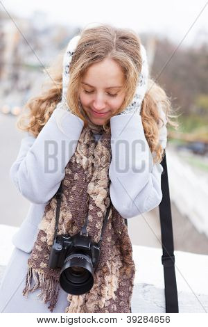 Frozen Woman Photographer With A Camera In Winter Clothes