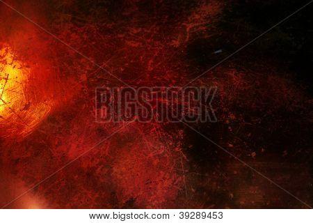 Fundo Grunge vermelho escuro com textura e brilho ouro