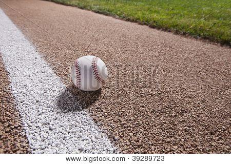 Baseball On A Base Path Under Lights At Night