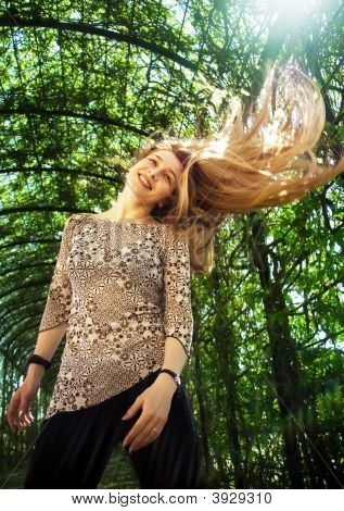 Woman With Her Nice Blond Hair In The Air