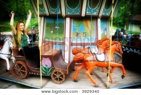 Young Woman In Spinning Carousel