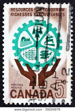 Postage stamp Canada 1961 Hands Holding Cogwheel with Natural Resources