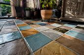 picture of floor covering  - Colorful tile plunch on the floor in a living room - JPG
