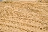 picture of nonrenewable  - many truck car tracks near sand pit construction - JPG