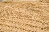 stock photo of nonrenewable  - many truck car tracks near sand pit construction - JPG