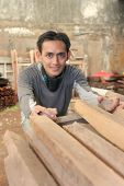stock photo of masker  - Man at Lumber or timber with mask on his neck - JPG