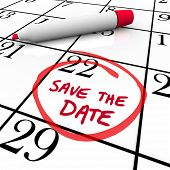 picture of reminder  - The words Save the Date written on a big white calendar to remind you to make and keep an important appointment or attend a major event or function - JPG