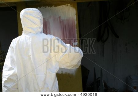 Worker Painting The Wall