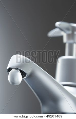 Tap with large drop of water