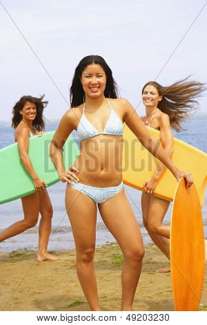 Young women holding boogie boards