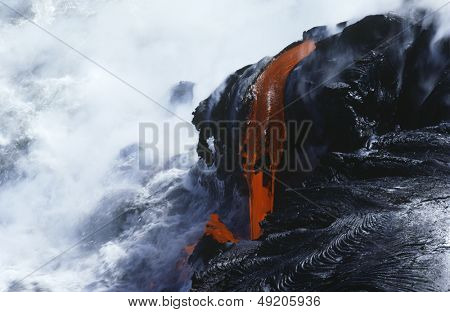 USA Hawaii Big Island Volcanos National Park cooling lava and surf