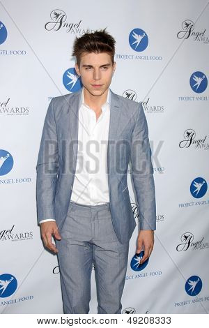 LOS ANGELES - AUG 10:  Nolan Funk at the Angel Awards at the Project Angel Food on August 10, 2013 in Los Angeles, CA
