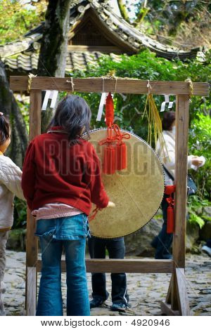 Young Girl Plays A Taiko Drum