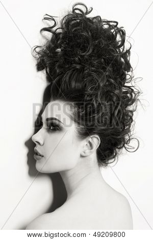 Duotone shot of young beautiful woman with long curly hair