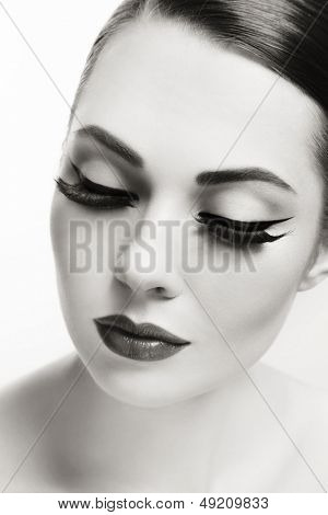Close-up duotone portrait of young beautiful woman with eyeliner