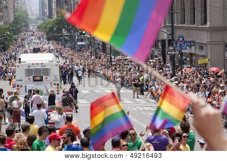 NEW YORK-JUN 30: Rainbow flags are wave in celebration as thousands of spectators line the sidewalks for the 44th Annual NYC Pride March down 5th Avenue on June 30, 2013 in Manhattan.