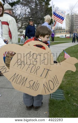Young Boy Holds Tea Pot Cutout Sign.
