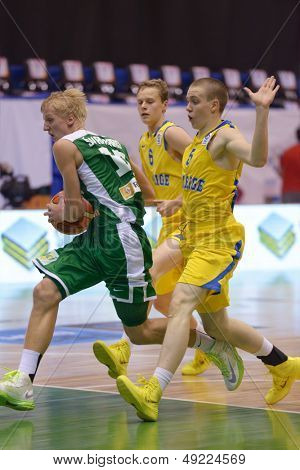 KIEV, UKRAINE - AUGUST 8: Jokubas Svambaris of Lithuania attacks during the U16 Eurobasket  2013 First round match between Sweden and Lithuania at Palace of Sport in Kiev, Ukraine on August 8, 2013