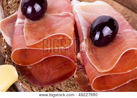 slices of bread with spanish serrano ham