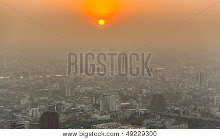 View Across Bangkok Skyline Showing In Sunset With Smog And Dust In The Air