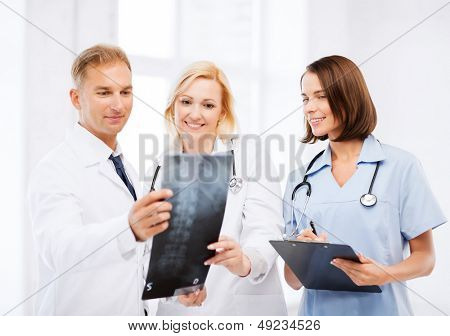 healthcare, medical and radiology concept - doctors looking at x-ray