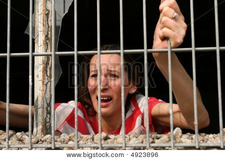 Kidnapped Woman Behind Bars Crying