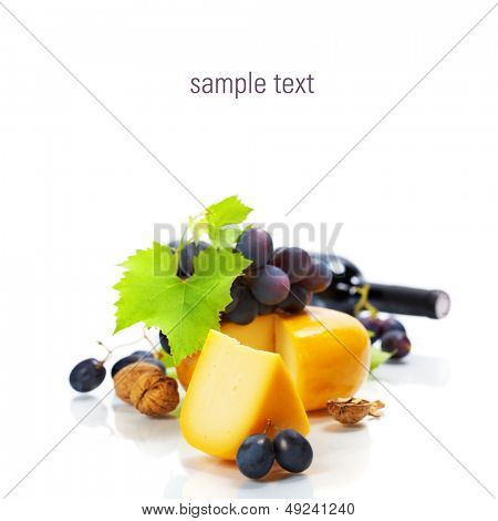 Grape and cheese with a bottle of red wine over white