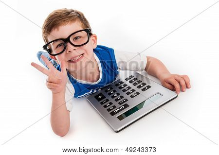 Boy Holding Up Three Fingers And A Big Calculator.