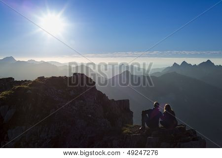couple sitting on rock